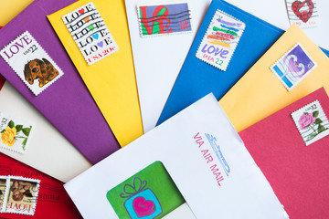 Envelopes of different colors with Love Stamps
