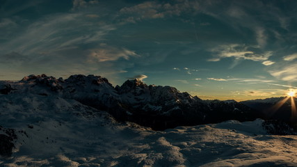 Sun going down over Brenta Dolomites winter time lapse