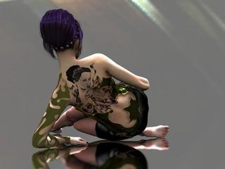 Tattooed woman on reflective surface