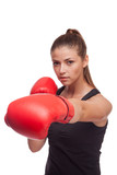 sport young woman with red gloves going to fighting