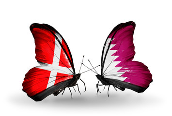 Two butterflies with flags Denmark and Qatar