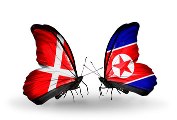 Two butterflies with flags Denmark and North Korea