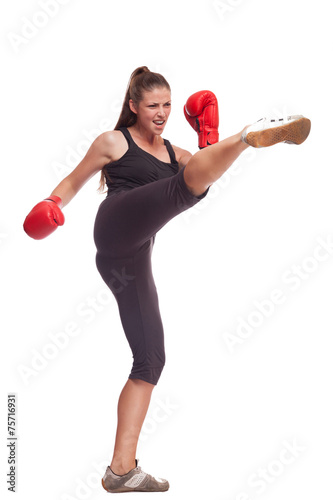 sport young woman with red gloves going to fighting - 75716931