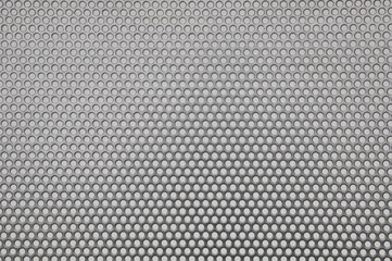 Metal surface with holes, industrial background