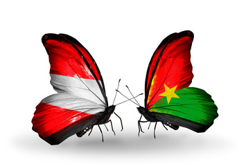 Two butterflies with flags Austria and Burkina Faso