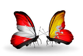 Two butterflies with flags Austria and  Bhutan