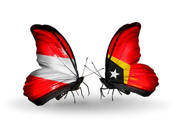 Two butterflies with flags Austria and East Timor