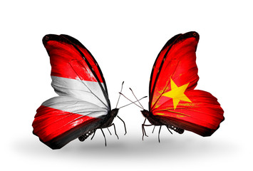 Two butterflies with flags Austria and Vietnam