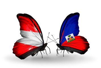 Two butterflies with flags Austria and Haiti