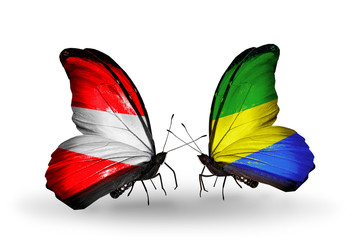 Two butterflies with flags Austria and Gabon