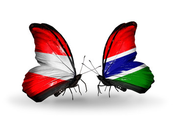 Two butterflies with flags Austria and Gambia