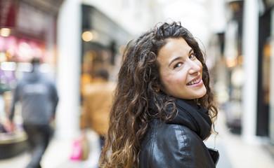 Attractive woman smiling back over her shoulder