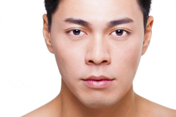 closeup young  asian man face isolated on white