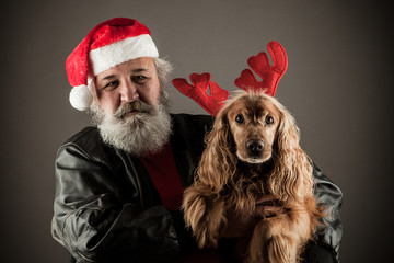 Santa Claus  with his dog  as Rudolph