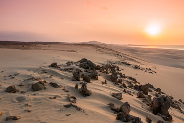 Sunset on sand dunes  in Chaves beach Praia de Chaves in Boavist