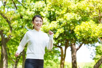 young asian woman running in the park