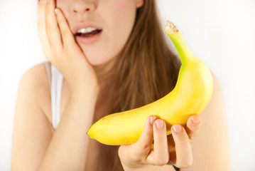 A young woman with a banana