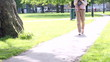 Attractive woman walking and using her phone in a park
