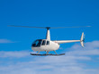 Helicopter flying in the blue sky - 75719179
