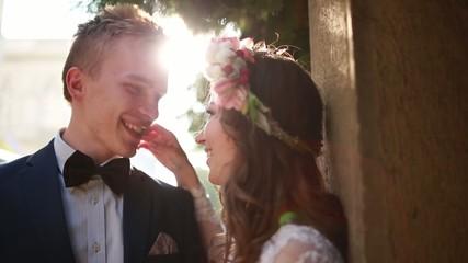 Newlyweds embracing on their wedding day