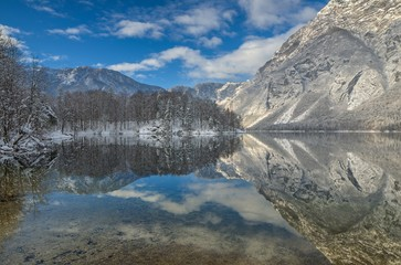 Reflection of mountains in a lake in winter