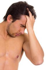 muscular shirtless man with headache