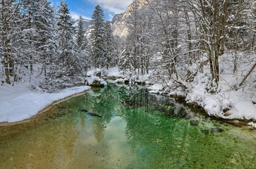 Colorful river in snowy winter