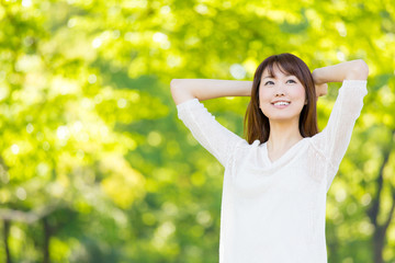 young asian woman relaxing in the park