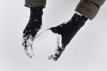 Snowball in woman hands