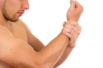 muscular shirtless man with wrist pain