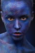 art photo of a beautiful woman with blue face