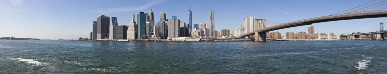 The New York City skyline w Brooklyn Bridge-extra large