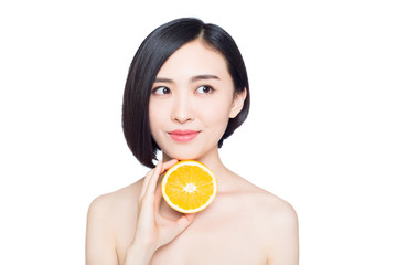 chinese woman with oranges in her hands