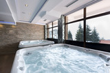 Jacuzzi baths in hotel spa center  - 75722738