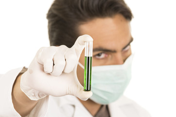 male lab researcher technician scientist doctor holding test