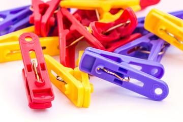 Clothespin clips on isolated white background