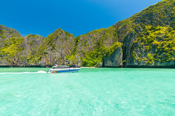 Motor boat on turquoise water of Maya Bay lagoon
