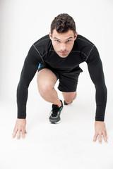 Male runner in starting position