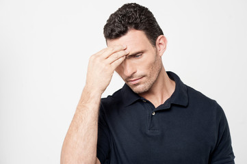 Worried man trying to remember something