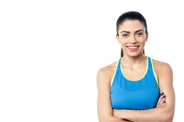 Young fit woman with arms folded
