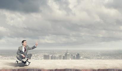 Business man riding bike