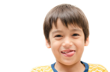 Little boy smiling with tongue out after eat something delicious