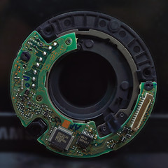 Electronic printed circuit boards control the camera lens.