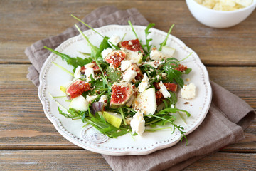 Delicious salad with arugula, sliced pears and figs