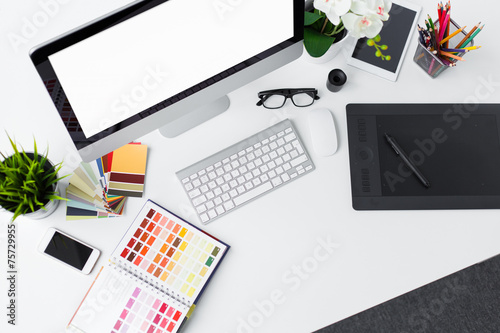Creative professional designer's desk from above - 75729955