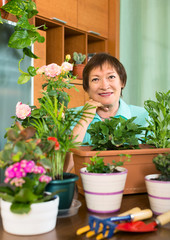 Smiling elderly woman and  her small garden