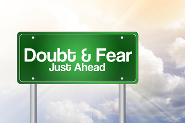 Doubt and Fear Just Ahead Green Road Sign  Business Concept