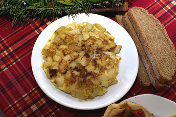 Tortilla de patata on white plate, Mallorca, Spain.