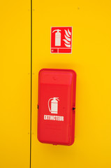 France, sign of a fire extinguisher on a yellow door