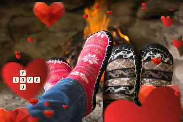 Close up of romantic legs in socks in front of fireplace